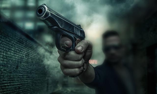 zbraň v ruce